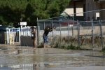 Bad parents lets their kids play in flooded areas.