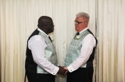 Sam Glass and Woody Goulart exchanging vows.